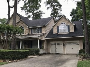 New Roof Replacement in The Woodlands Tx. with Certainteed Landmark Lifetime Shingle in Weathered Wood with Timber Tex Hip & Ridge Row.