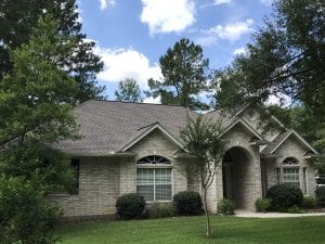 New Roof Replacement in The Woodlands Tx. with Timberline HDZ Lifetime Shingle in Weathered Wood with Timber Tex Hip & Ridge Row.